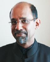 Dr.  John Tharakan